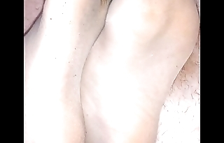 homemade footjob with ripped nylonsocks together with cumshot