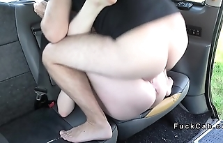Redhead pissing in front of cab driver
