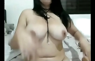 Chubby with big boobs toys herself on cam